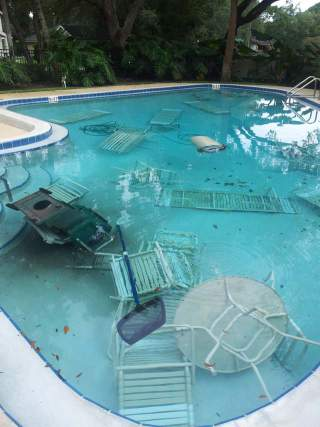 Furniture thrown into pool